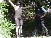 2 dominatrix's abusing guy's balls outdoors