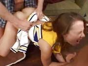 Redhead cheerleader fucking and sucking in threesome on couch