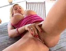 large fake boobies and a pierced clit