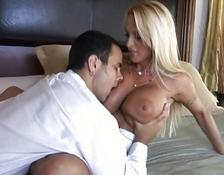 pretty yellow-haired with humongous breasts teasing a guy and gets him horny