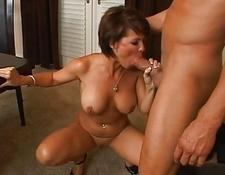 Hot brunette milf with enormous titties swallowing humongous fat penis