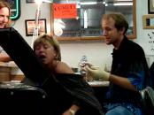 crazy granny screams and moves while getting a tattoo