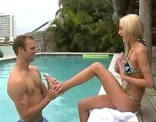 Bikini Babe with enormous breasts is a Poolside bitch