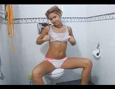 sexy blondy teen teasing naked on a toilet