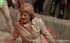 Party ladies getting wet and messy in mud fights