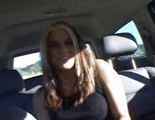 beautiful superb redhead babe undressing in the car