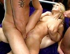 Double penetration happens with a blondy woman with shaved pussy