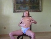 sexy milf gives hot striptease on chair