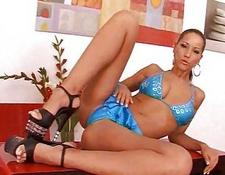 Busty brunette in blue lingerie and black high heels rides