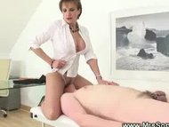 Prodomme working her slaves penis before facesitting