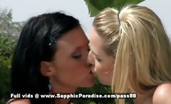 Aneta and Debby yellow-haired and brunette lesbian babes kissing in the garden
