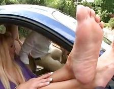 Hot blonde enjoys foot sex