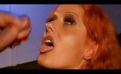 Italian redhead MILF bangs two penises and gets a messy facial