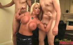 Busty blonde Alura does a striptease and poses with 2 cocks