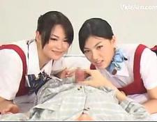 two asian skanks Watching How guy Jerking In Pijama On The Bed
