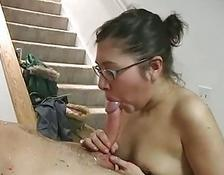 young woman with glasses giveshornyl oral sex