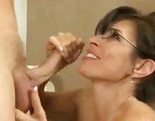older chick with ebony glasses rides younger stud