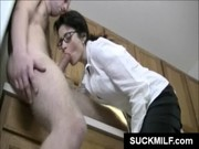 MILF in glasses eats dong in kitchen