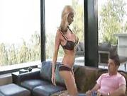 yellow-haired in black lingerie rides man on couch