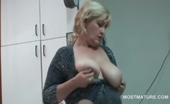 Office girl teasing her mature tits with a banana
