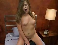 Babe mounts Sybian and fucks machine with big dildo in bed