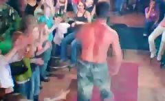 charming muscled stripper dancing at a CFNM sex party
