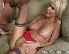 old blondy and two ebony rods in her hot holes