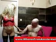 yellow-haired prostitute gives oral sex
