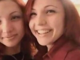 Twin redheaded sisters by anonymous