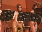 Japanese Orchestra Group Performs Naked On Stage