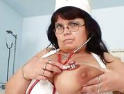 enormous breasts Milf nurse shows off her massive mellons