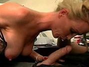 gorgeous MILF with enormous boobs Gives Out Office Blowjobs