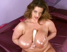 Mega breasted oiled MILF toys her hungry chunky pussy