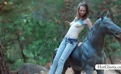 Gloria riding a horse strips to masturbate outdoor