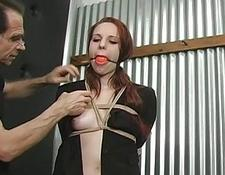 Slave gagged and cunt whipped
