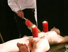 Slave girl candle waxed and clamped