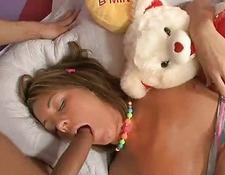 huge rod is shoved in her face while she is sleeping