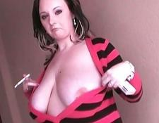 Smoking whore exposes her enormous boobs