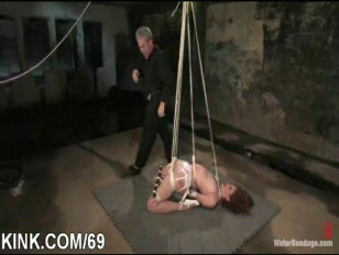 Hot busty attractive broad in strict bondage.