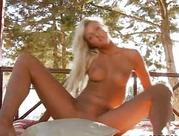Smoking hot yellow-haired riding a toy outdoors