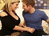 Busty yellow-haired Sara Jay helps sons friend get off by letting him titty fuck