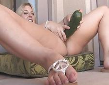 Avril adorable yellow-haired girl masturbating with a zucchini and having climax