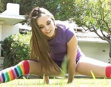Mila sporty brunette teen with long hair and natural breasts undressing and exercising outdoors