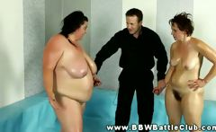 humongous BBW wins wrestling match and she grabs referees hard dong