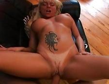 Heavy chested blondy with tattoo and pierced cunt gets sexed