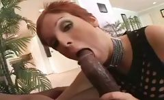 Short-haired redhead with nice boobies shags a gigantic black penis