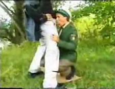 lady in uniform screwed on the grass