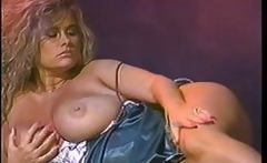 Trinity Loren is a blonde vintage porn babe who plays with her melons