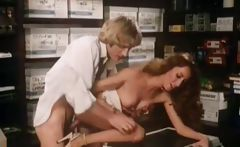 Classic three-way scene in the copy room from some porn stars