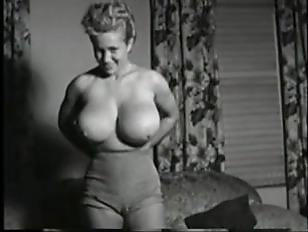 Vintage Clip of hot large melons yellow-haired.
